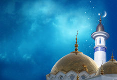 Crescent moon at a top of a mosque. Ramadan Kareem background.Crescent moon at a top of a mosque Royalty Free Stock Image
