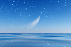 Crescent over sea Stock Images