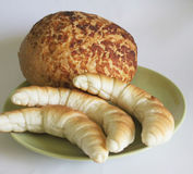 Crescent rolls and bread Stock Images
