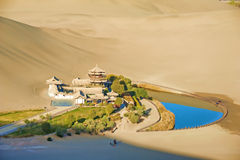 Crescent Spring and Mingyue Pavilion in Dunhuang of. Crescent Spring and Mingyue Pavilion in the morning, Dunhuang of China Stock Images