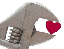 Crescent wrench and heart Stock Images