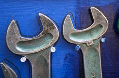 Crescent wrenches. On a wooden background Royalty Free Stock Photography