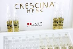 Crescina HFSC再生物细颈瓶在Crescina治疗箱子的 免版税库存图片