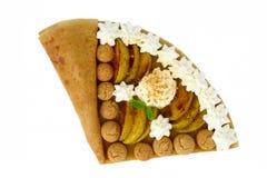 Crespón con las manzanas y las galletas de almendra caramelizadas Imagen de archivo libre de regalías