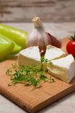 Cress shoots in front of camembert portions Royalty Free Stock Images