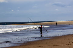 Cresswell beach, northumberland, England. Cresswell beach at the southern end of Druridge Bay in Northumberland, England. In the foreground are sea fishermen on Royalty Free Stock Photography