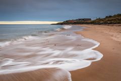 Cresswell Village from the beach. Druridge Bay is a seven mile long beach in Northumberland between Amble to the north and Cresswell to the south Stock Photos