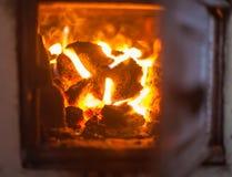 Crest of flame on burning wood Stock Photo