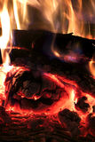 Crest of flame on burning wood in fireplace Royalty Free Stock Image