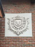 Crest. With fluer de lis on brick wall Stock Photography