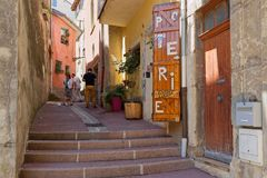 An old street in Crest. CREST, FRANCE, June 19, 2018 : People in the old streets of the city of Crest, in Drome region of the South of France royalty free stock image