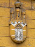 Crest of Krakow. Detail from tenement wall, Krakow, Poland Royalty Free Stock Photo