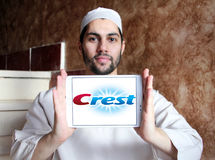Crest logo. Logo of toothpaste brand crest on samsung tablet holded by arab muslim man Stock Photos
