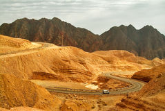 Crest of mountain Shlomo. Dark and orange mountains in desert  near to the city of Eilat in Israel Royalty Free Stock Photography