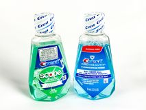 Travel Size Bottles of Crest Mouthwash on a White Backdrop. Crest Mouthwash bottles on a White Backdrop Royalty Free Stock Photos