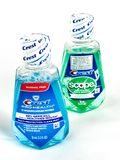 Travel Size Bottle of Crest Pro-Health Mouthwash on a White Backdrop. Crest Pro-Health Mouthwash on a white backdrop Stock Images