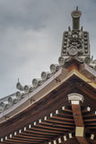 Crest of roof structure at Chion-in Buddhist Temple. Kyoto, Japan - September 16, 2016: Crest of wooden roof structure at Chion-in Buddhist Temple under cloudy Royalty Free Stock Photo