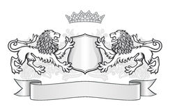 Crest with two lions, crown and a shield Royalty Free Stock Image