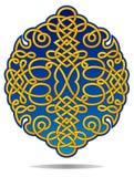 Cresta afiligranada adornada en azul y oro Imagen de archivo libre de regalías