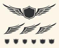 Cresta coa alas Imágenes de archivo libres de regalías