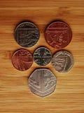 Cresta hecha de monedas Foto de archivo libre de regalías