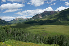 Crested Butte Colorado in the Summertime. Crested Butte, Colorado, in the summertime. The mountains and hills are a lush green this time of the year royalty free stock images