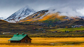 A Crested Butte Fall. A glimpse at Colorado life in Crested Butte, Colorado during fall as a horse barn lays below Gothic Mountain stock photos