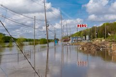 Cresting Illinois River. Illinois River cresting on Water Street in Peru, Illinois.  May 3rd, 2019 royalty free stock images