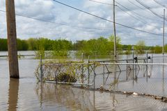 Cresting Illinois River. Illinois River cresting on Water Street in Peru, Illinois.  May 3rd, 2019 royalty free stock photography