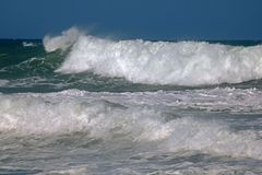CRESTING WAVE BREAKING INTO FOAM Stock Photo