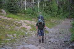 Crestone, Colorado - August 27 2015 - Man hiking South Colony Trail in Sangre de Cristo Wilderness area royalty free stock photography