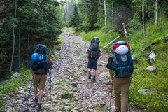 Crestone, Colorado - August 27 2015 - Men backpacking South Colony Trail in Sangre de Cristo Wilderness area stock photo