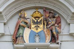 The crests of Lucerne and the Imperial Eagle flanked by St Leodegar and St Maurice, church of St. Leodegar in Lucerne. The crests of Lucerne and the Imperial stock photos