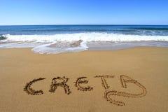 Creta op het strand wordt geschreven dat Stock Fotografie