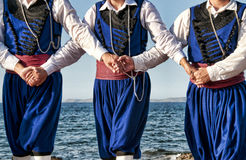 Cretan dancers. Traditionally dressed Cretans dancers holding each other royalty free stock images
