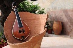 Cretan Lyra. The traditional Cretan Lyra with a pottery Stock Image