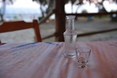 Cretan raki. Glasses of raki on a traditional cretan scarf Stock Photo