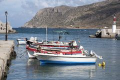 The Cretan resort of Milatos on the north coast. Milatos, Crete, Greece. 2017. The small fishing harbour with mountains joining the Sea of Crete Stock Photos