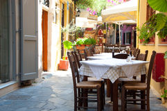 Cretan restaurant in Chania. Image of a greek outdoor restaurant with menu, serving different fish specialities. Picture taken on august 2011, in the venetian Stock Images