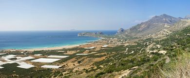 Cretan Seashore. Panoramic view of a Cretan coast. Photo taken in a North-West part of the island. The place is called Falasarna Beach. White shapes are the Stock Photos