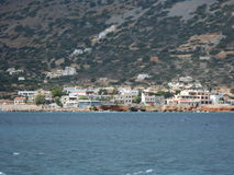 Cretan village seen from a boat. Small village photographed from a boat in return for excursion on one of the many Cretan islands Stock Photography