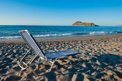 Crete. A sunbed on the beach on beautiful Crete Royalty Free Stock Image