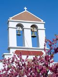CRETE ,Church Belltower. Church bell tower and spring blossom stock image