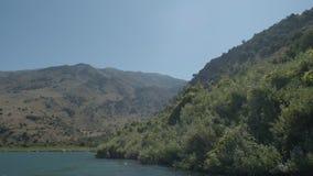 Crete. Cinematic POV of a boat floating on the turtle lake thru sun-flares. Europe. Greece. Crete. Cinematic POV of a boat floating on the turtle lake thru sun stock footage