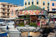 Sea souvenir shop organised a boat is stying moored at pot of Chania town. CRETE, GREECE - AUGUST 2018: Sea souvenir shop organised a boat is stying moored at stock images