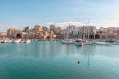 Crete, Greece - February, 11, 2019: Boats and yachts in the port on the background of Heraklion city. Greece royalty free stock image