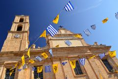 Crete, Greece: Greek Orthodox Church with Flags Royalty Free Stock Photo