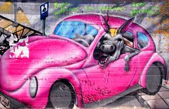 Colorful graffiti urban art with fun car. CRETE, GREECE - JULY 24, 2016: Colorful graffiti urban art with fun car and jackass on the street walls Royalty Free Stock Photo