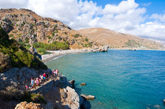 CRETE,GREECE-JULY 23:Tourists come down on the Preveli Beach on July 23,2014 on Crete, Greece. The beach of Preveli is situated 40 Royalty Free Stock Photo