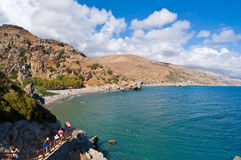 CRETE,GREECE-JULY 23:Tourists go down to the Preveli Beach on July 23,2014 on Crete, Greece. The beach of Preveli is situated 40 k Royalty Free Stock Photo